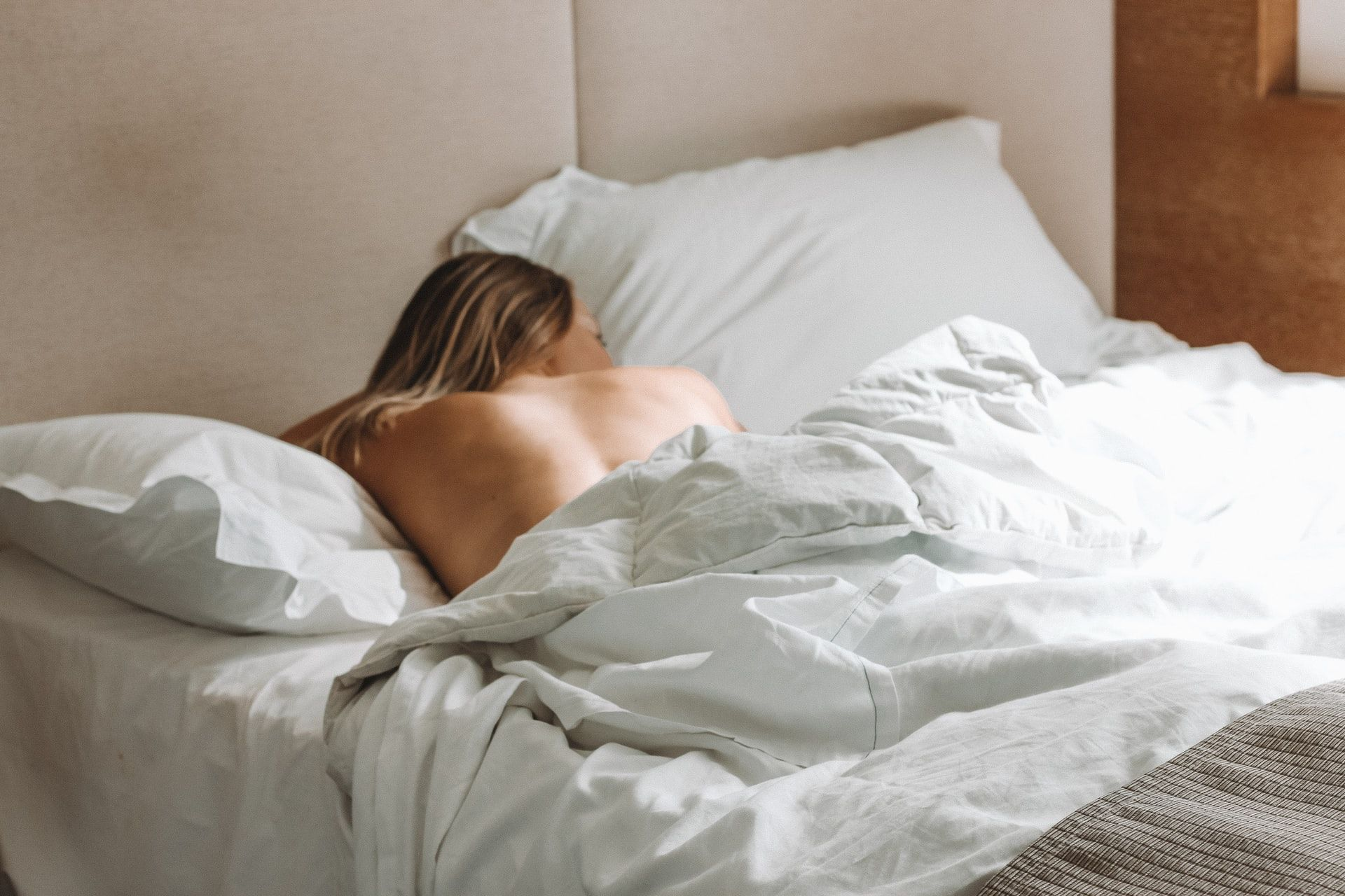 woman on bed naked back