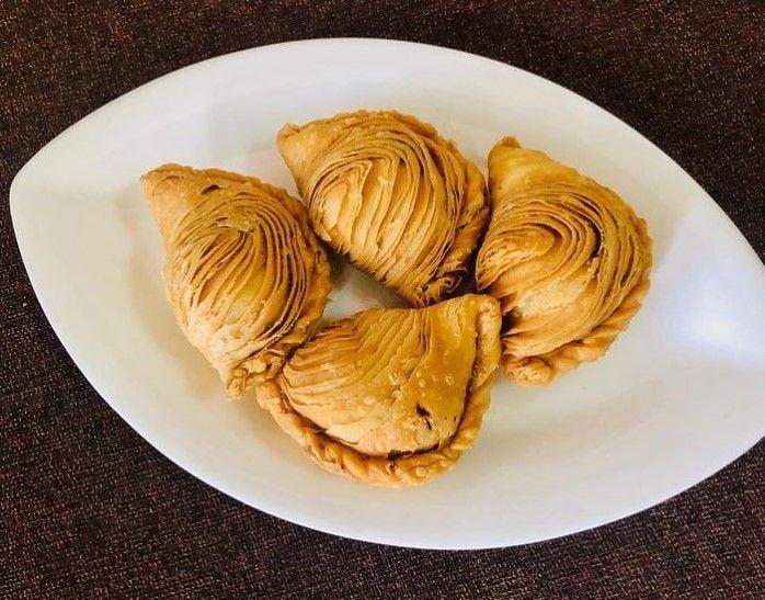 Four Wang Wang Crispy Curry Puffs on a white plate