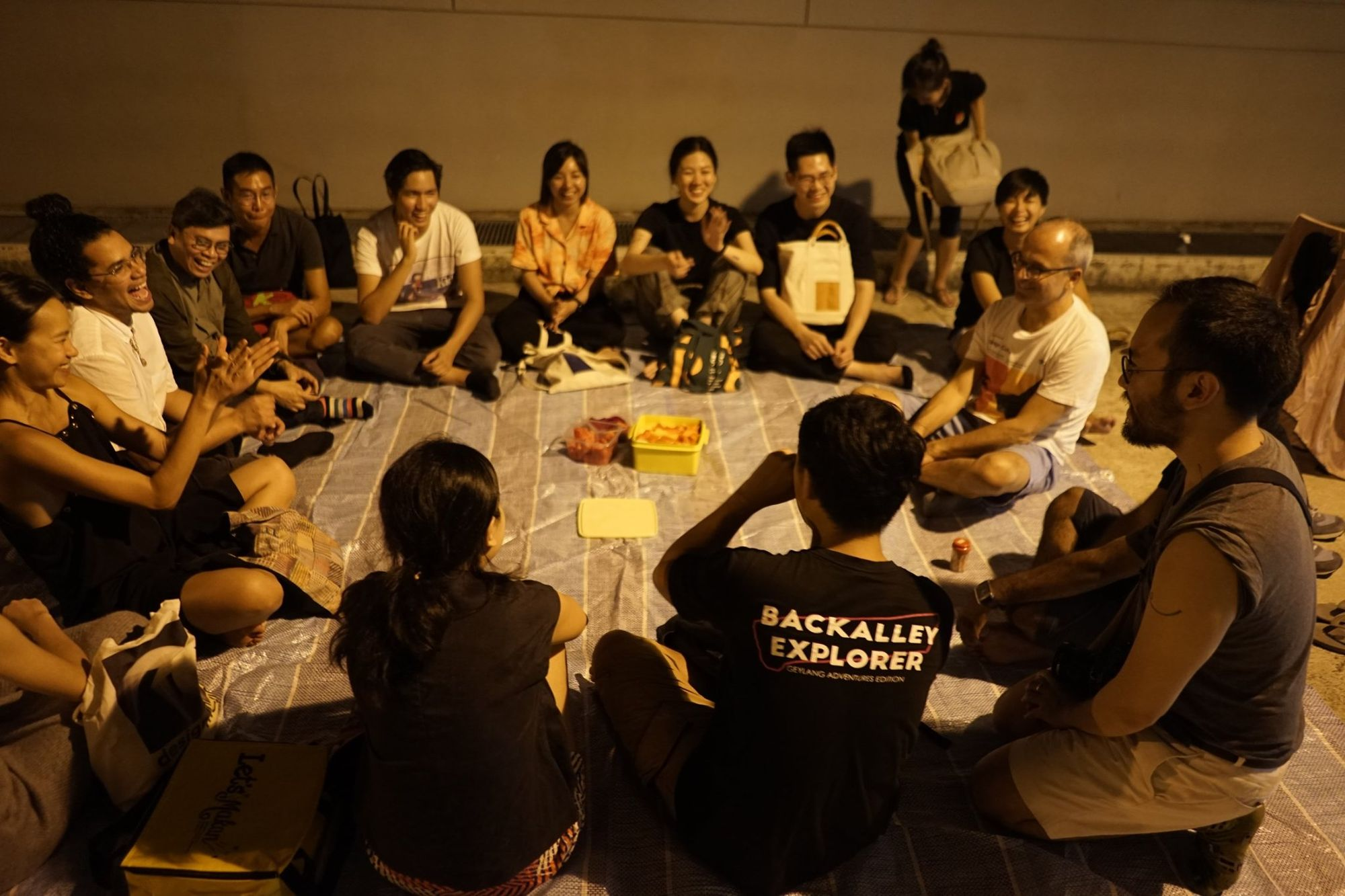 Participants sitting in a circle on Geylang adventure tour